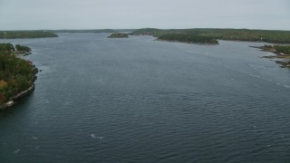 AX147_399 - 6k stock footage aerial video flying over Kennebec River, approach Perkins Island, Marr Island, Georgetown, Maine