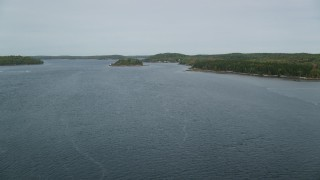 AX147_400 - 6k stock footage aerial video flying over Kennebec River, approach Perkins Island, autumn, Georgetown, Maine
