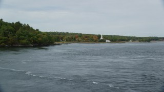 AX147_403 - 6k stock footage aerial video of Phippsburg Congregational Church, waterfront home, autumn, Phippsburg, Maine