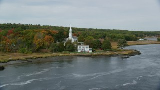 AX147_404 - 6k stock footage aerial video of Phippsburg Congregational Church, waterfront home, autumn, Phippsburg, Maine