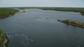 AX147_406 - 6k stock footage aerial video flying over Kennebec River in autumn, Phippsburg, Maine