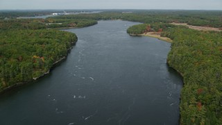 AX147_408 - 6k stock footage aerial video flying over the Kennebec River, shores lined with colorful trees, Phippsburg, Maine