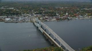 AX147_413 - 6k stock footage aerial video flying by Sagadohoc Bridge, small town, autumn, Bath, Maine