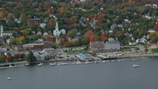 AX147_414 - 6k stock footage aerial video flying by small waterfront town, church, autumn, Bath, Maine
