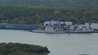 AX147_415 - 6k stock footage aerial video flying away from waterfront factory, autumn, Bath, Maine