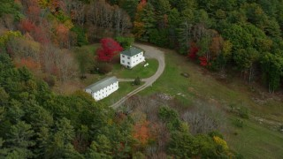 AX147_417 - 6k stock footage aerial video flying by rural homes, tilt down, autumn, Woolwich, Maine