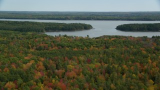 AX147_419 - 6k stock footage aerial video flying by Montsweag Bay, colorful forest, autumn, Woolwich, Maine