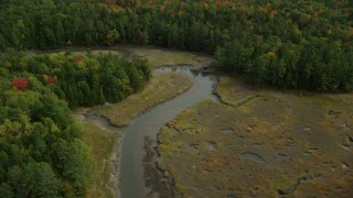 AX147_421 - 6k stock footage aerial video flying by river through marshland, surrounded by forest, autumn, Woolwich, Maine