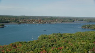 AX148_003 - 6k stock footage aerial video flying over Sheepscot River, approaching small town, autumn, Wiscasset, Maine