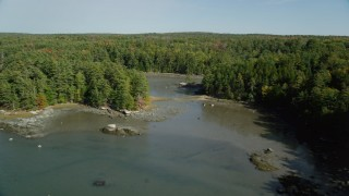 AX148_016 - 6k stock footage aerial video flying over Damariscotta River, forest, isolated homes, autumn, Damariscotta, Maine