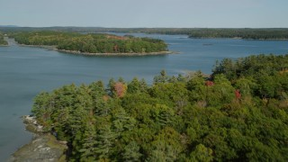 AX148_029 - 6k stock footage aerial video approaching forested islands, The Narrows, autumn, Waldoboro, Maine