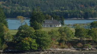 AX148_030 - 6k stock footage aerial video flying by an isolated rural home, autumn, Waldoboro, Maine