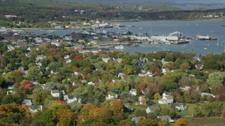 AX148_077 - 6k stock footage aerial video flying by Rockland Harbor, small coastal town, autumn, Rockland, Maine