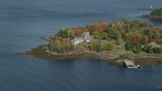 AX148_080 - 6k stock footage aerial video flying by waterfront homes, colorful foliage, autumn, Owls Head, Maine