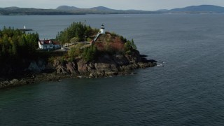 AX148_082 - 6k stock footage aerial video orbiting Owls Head Light, fall foliage, autumn, Owls Head, Maine