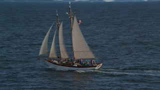 AX148_107 - 6k stock footage aerial video orbiting a sailboat on West Penobscot Bay, Rockport, Maine