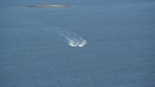 AX148_123 - 6k stock footage aerial video tracking a boat on West Penobscot Bay, Camden, Maine