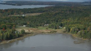 AX148_127 - 6k stock footage aerial video flying by rural autumn, Isleboro Island, autumn, Islesboro, Maine