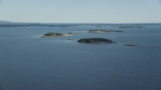 AX148_129 - 6k stock footage aerial video approaching small islands, Hog Island, Maine