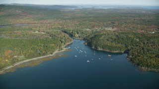 AX148_154 - 6k stock footage aerial video approaching boats in Seal Cove, Mount Desert Island, autumn, Tremont, Maine