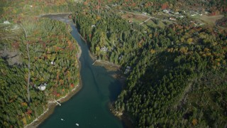 AX148_155 - 6k stock footage aerial video flying over Seal Cove, Tremont Road, waterfront homes, autumn, Tremont, Maine