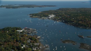 AX148_161 - 6K stock footage aerial video flying by small coastal town, autumn, Southwest Harbor, Maine