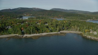 AX148_164 - 6K stock footage aerial video flying by small coastal town, Northeast Harbor, Mount Desert Island, Maine