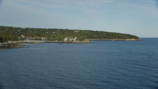 AX148_168 - 6K stock footage aerial video flying by waterfront mansion, autumn, Seal Harbor, Mount Desert Island, Maine
