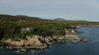 AX148_171 - 6K stock footage aerial video flying by waterfront mansions, autumn, Seal Harbor, Mount Desert Island, Maine