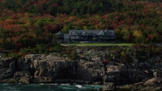 AX148_172 - 6K stock footage aerial video flying by an isolated waterfront mansion, autumn, Seal Harbor, Mount Desert Island,  Maine