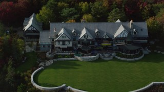AX148_174 - 6K stock footage aerial video approaching isolated mansion and tilt down, autumn, Seal Harbor, Maine