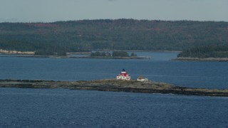AX148_182 - 6K stock footage aerial video flying by Egg Rock Light, Egg Rock, autumn, Bar Harbor, Maine