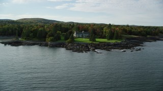 AX148_192 - 6K stock footage aerial video approaching waterfront homes, autumn, Bar Harbor, Maine