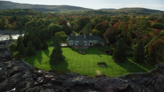 AX148_193 - 6K stock footage aerial video flying by waterfront homes, colorful trees, autumn, Bar Harbor, Maine