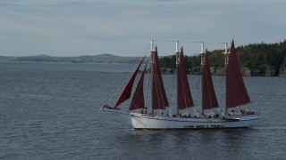 AX148_196 - 6K stock footage aerial video flying by sailing ship in Bar Harbor, Maine
