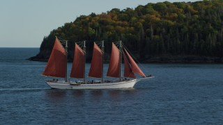 AX148_199 - 6K stock footage aerial video of a sailing ship in Bar Harbor, Maine