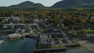 AX148_201 - 6K stock footage aerial video approaching Harborside Hotel, Spa and Marina in autumn, Bar Harbor, Maine