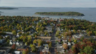 AX148_206 - 6K stock footage aerial video flying over Main Street in a coastal town in autumn, Bar Harbor, Maine