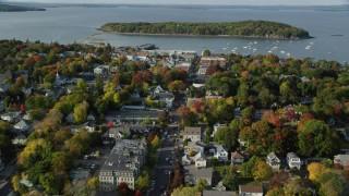 AX148_207 - 6K stock footage aerial video flying toward harbor over Main Street in coastal town, autumn, Bar Harbor, Maine