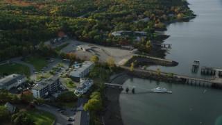 AX148_223 - 6K stock footage aerial video tilting down on Atlantic Oceanside hotel near the harbor, autumn, Bar Harbor, Maine