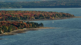AX149_006 - 6K stock footage aerial video of a forest with fall foliage along a cove, Trenton, Maine