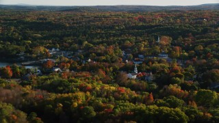 AX149_017 - 6K stock footage aerial video flying by quaint coastal town among fall foliage, Blue Hill, Maine