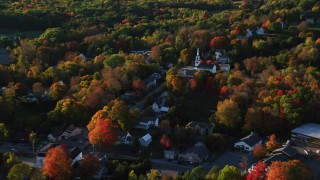 AX149_032 - 6K stock footage aerial video orbiting homes and white church in small coastal town, Blue Hill, Maine