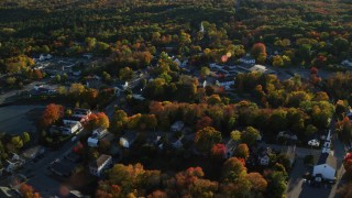 AX149_033 - 6K stock footage aerial video flying over small coastal town homes and streets in autumn, Blue Hill, Maine