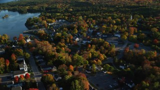 AX149_034 - 6K stock footage aerial video orbiting away from coastal town in autumn, Blue Hill, Maine