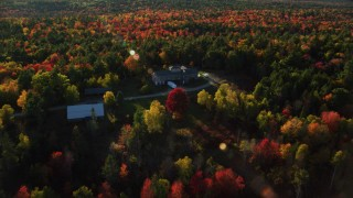 AX149_038 - 6K stock footage aerial video flying over and tilt down on isolated home among fall foliage, Blue Hill, Maine