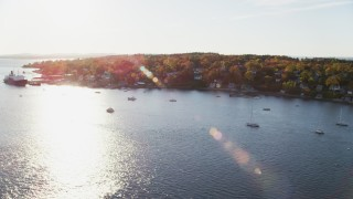 AX149_069 - 6K stock footage aerial video flying by a small coastal town, State of Maine training ship, autumn, Castine, Maine