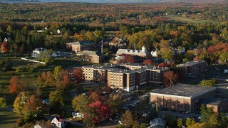 AX149_072 - 6K stock footage aerial video orbiting Maine Maritime Academy, autumn, Castine, Maine