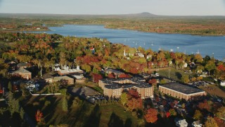 AX149_073 - 6K stock footage aerial video orbiting the Maine Maritime Academy among fall foliage, autumn, Castine, Maine