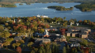 AX149_075 - 6K stock footage aerial video orbiting Maine Maritime Academy among a coastal town, autumn, Castine, Maine